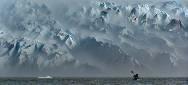 Packrafting in front of San Quintin glacier, Aisen, Patagonia, Chile