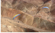 Paragliding above desert plateau of Altos de Chipana, Iquique, Atacama Desert, Chile