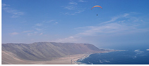 Starting an XC paragliding flight from San Marcos toward Iquique, Atacama Desert, Chile