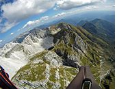 Paragliding above Krn mountain, Soca valley, Julian Alps, Slovenia